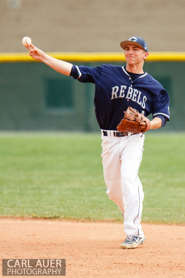 April 30th, 2013: Columbine Rebel senior Logan Smith (34) attempts to throw a runner out at first base in the game against the Ralston Valley Mustangs at Ralston Valley High School