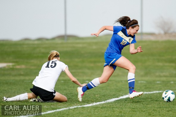 April 29th, 2013:  Wheat Ridge Farmers senior midfielder Macee Broer (10) breaks towards the goal past the fallen D'Evelyn Jaguars junior Emily Garnier (15) in the game at the North Area Athletic Complex in Arvada, Colorado