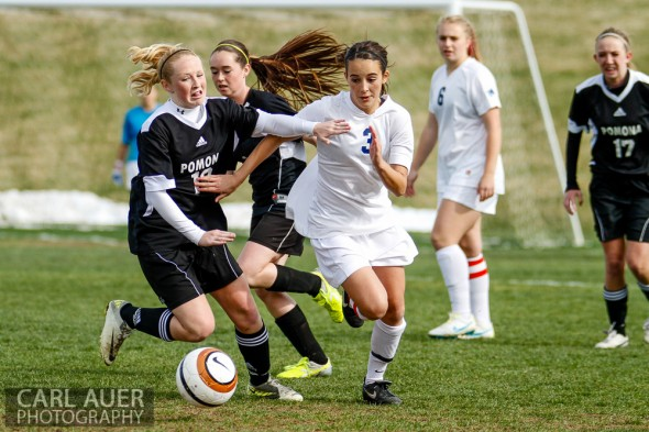 May 3rd, 2013: Ralston Valley Mustangs junior defender Shae Sellers (3) and a Pomona Panthers player chase after the ball in the game at the North Area Athletic Complex in Arvada, Colorado