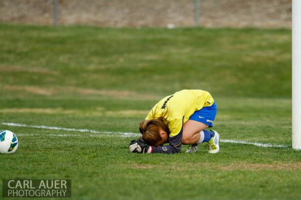 April 29th, 2013:  Wheat Ridge Farmers senior goalkeeper Carly Manahan (1) collapses to the grass after allowing the game winning goal past her in the game against the D'Evelyn Jaguars at the North Area Athletic Complex in Arvada, Colorado