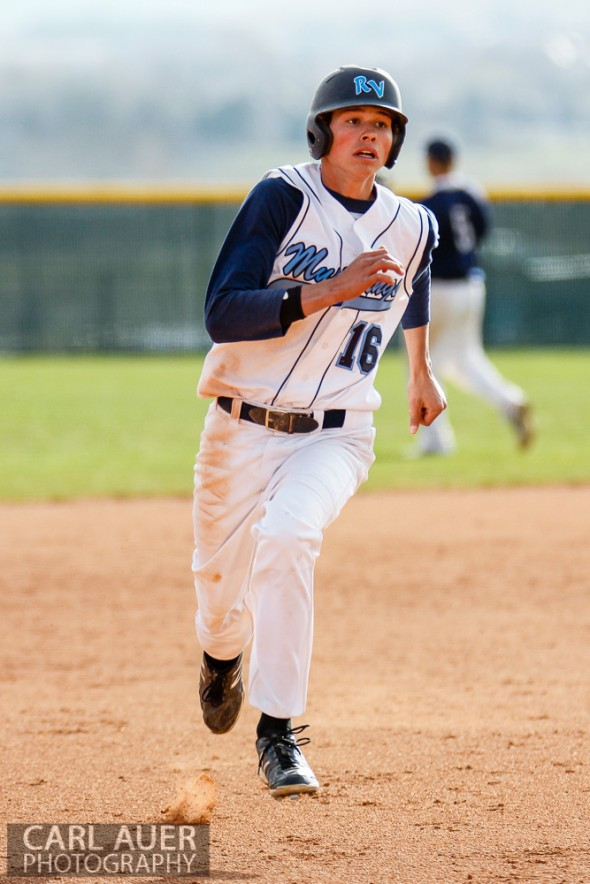 April 30th, 2013: Ralston Valley Mustangs junior Mitch Robinson (16) runs to third base after a ball reaches the outfield in the game against the Columbine Rebels at Ralston Valley High School