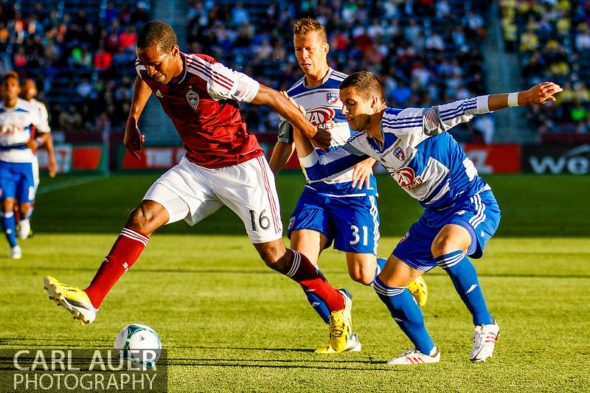 June 1st, 2013 - Colorado Rapids midfielder Atiba Harris (16) attempts to get the ball past FC Dallas midfielder Andrew Jacobson (4) and defender/midfielder  Michel (31) in the first half of action in the MLS match between FC Dallas and the Colorado Rapids at Dick's Sporting Goods Park in Commerce City, CO