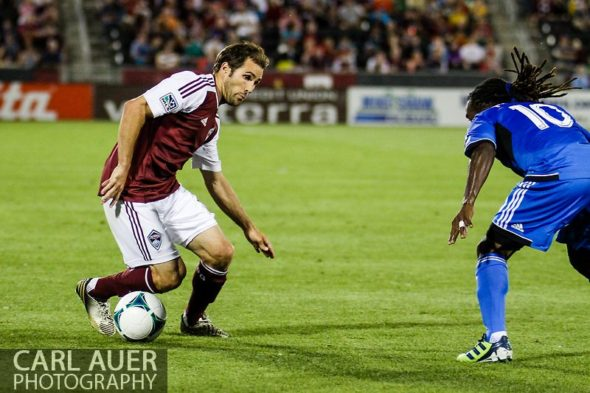 June 15th, 2013 - Showing off his ball handling skills, Colorado Rapids midfielder Brian Mullan (11) attempts to get past San Jose Earthquake midfielder Walter Martinez (10) in the second half of the MLS match between San Jose Earthquake and the Colorado Rapids at Dick's Sporting Goods Park in Commerce City, CO
