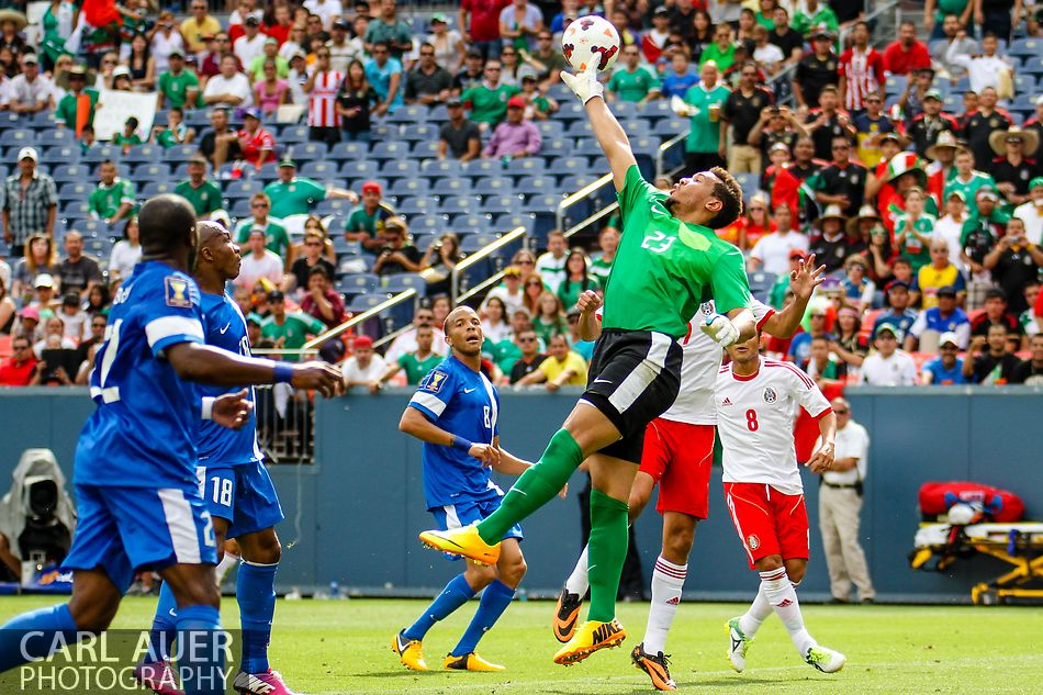 July 14 2013:  Martinique Goalie Kevin Olimpa (23) attempts to know the ball away in the first half of action in the CONCACAF Gold Cup soccer match between Martinique and Mexico at Sports Authority Field in Denver, CO. USA.