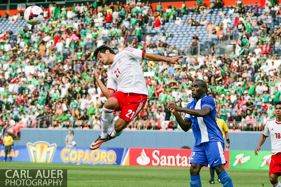 July 14 2013:  Mexico Forward Javier Orozco (21) goes airborne to attempt a shot off of a Mexico corner kick late in the second half of the CONCACAF Gold Cup soccer match between Martinique and Mexico at Sports Authority Field in Denver, CO. USA.