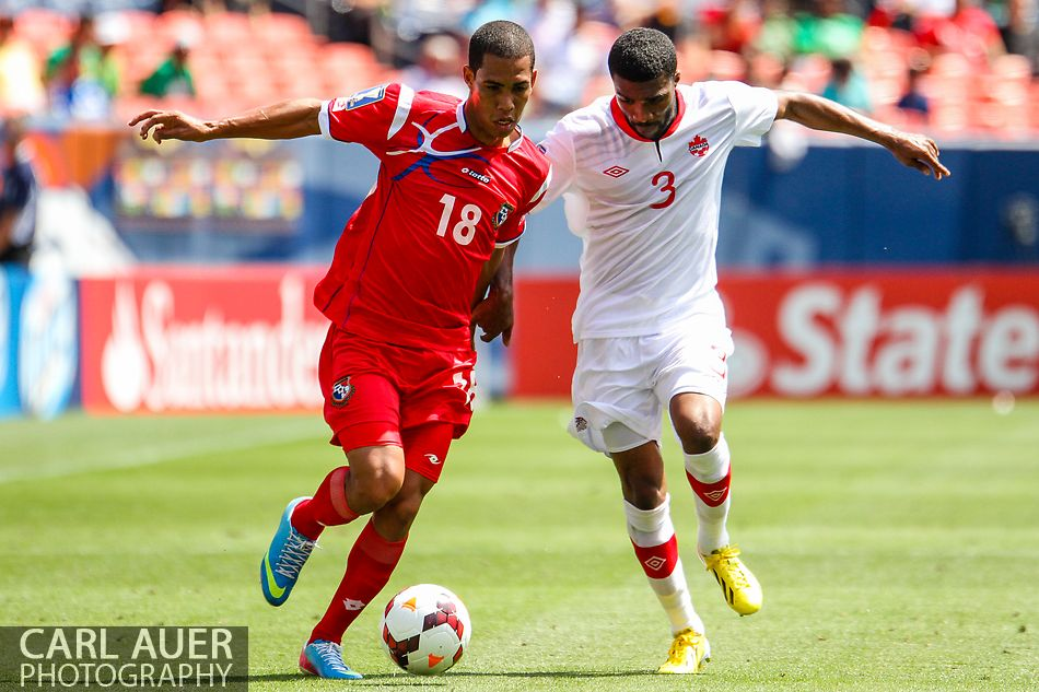 July 14 2013:  Canada Defender Ashtone Morgan (3) attempts to stop Panama Midfield Jairo Jimenez (18) during the CONCACAF Gold Cup soccer match between Panama and Canada at Sports Authority Field in Denver, CO. USA.