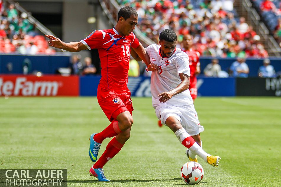 July 14 2013:  Panama Midfield Jairo Jimenez (18) and Canada Defender Ashtone Morgan (3) fight for control of the ball in the second half of the CONCACAF Gold Cup soccer match between Panama and Canada at Sports Authority Field in Denver, CO. USA.