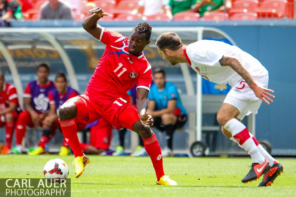 July 14 2013:  Panama Forward Cecilio Waterman (11) attempts to get around Canada Defender David Edgar (5) in second half action of the CONCACAF Gold Cup soccer match between Panama and Canada at Sports Authority Field in Denver, CO. USA.