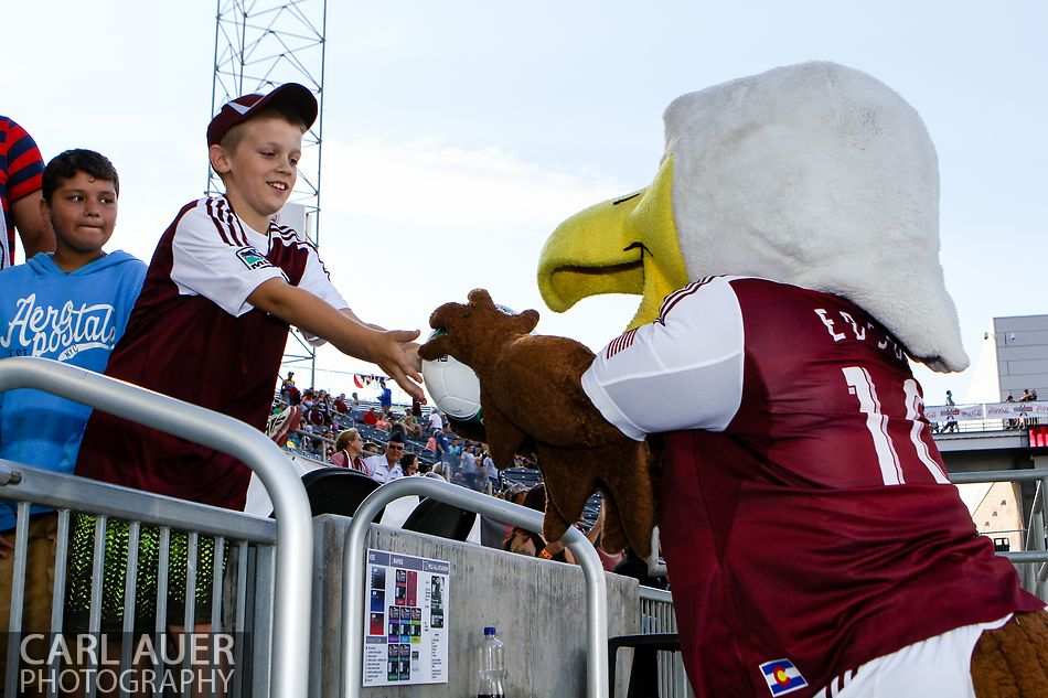 July 7th, 2013 - Edson the Eagle collects the game ball from a fan after it was passed down the stands prior to the start of action in the Major League Soccer match between D.C. United and the Colorado Rapids at Dick's Sporting Goods Park in Commerce City, CO