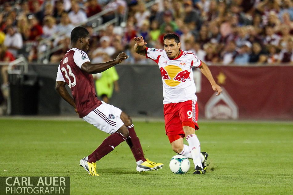 July 4th, 2013 - New York Red Bulls forward Fabian Espindola (9) attempts to dribble the ball past Colorado Rapids defender German Mera (33) in second half action of the Major League Soccer match between New York Red Bulls and the Colorado Rapids at Dick's Sporting Goods Park in Commerce City, CO