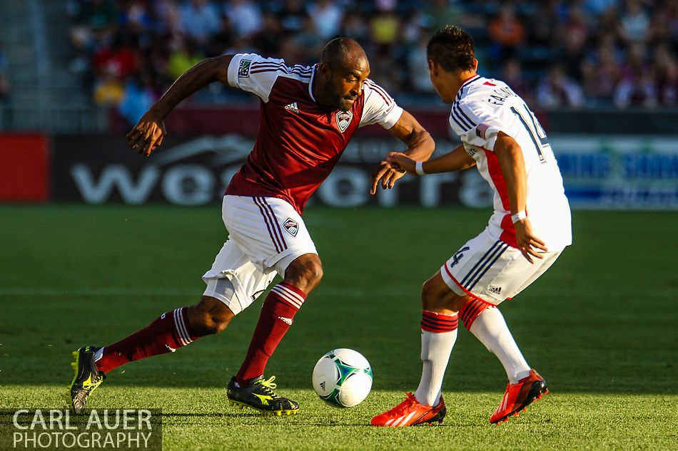 July 17th, 2013 - Colorado Rapids defender Marvell Wynne (22) attempts to drive the ball past New England Revolution forward Diego Fagundez (14) in first half action of the Major League Soccer match between the New England Revolution and the Colorado Rapids at Dick's Sporting Goods Park in Commerce City, CO