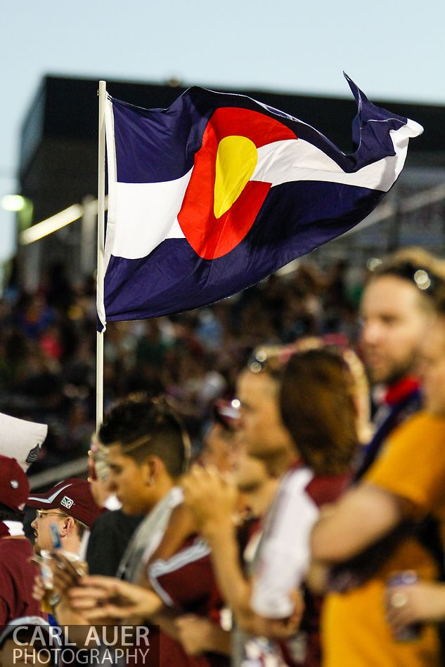 July 17th, 2013 - A Colorado state flag is waved by a Rapids fan after a Colorado goal in the second half of action in the Major League Soccer match between the New England Revolution and the Colorado Rapids at Dick's Sporting Goods Park in Commerce City, CO