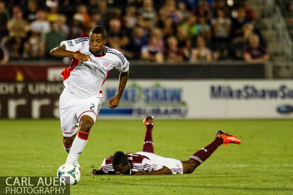 July 17th, 2013 - Leaving Colorado Rapids midfielder Atiba Harris (16) face down on the field, New England Revolution defender Andrew Farrell (2) storms down the pitch with the ball in the second half of the Major League Soccer match between the New England Revolution and the Colorado Rapids at Dick's Sporting Goods Park in Commerce City, CO