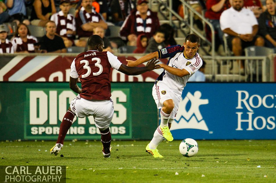 August 3rd, 2013 - Real Salt Lake midfielder Luis Gil (21) pushes his way past Colorado Rapids defender German Mera (33) in the first half of action in the Major League Soccer match between Real Salt Lake and the Colorado Rapids at Dick's Sporting Goods Park in Commerce City, CO