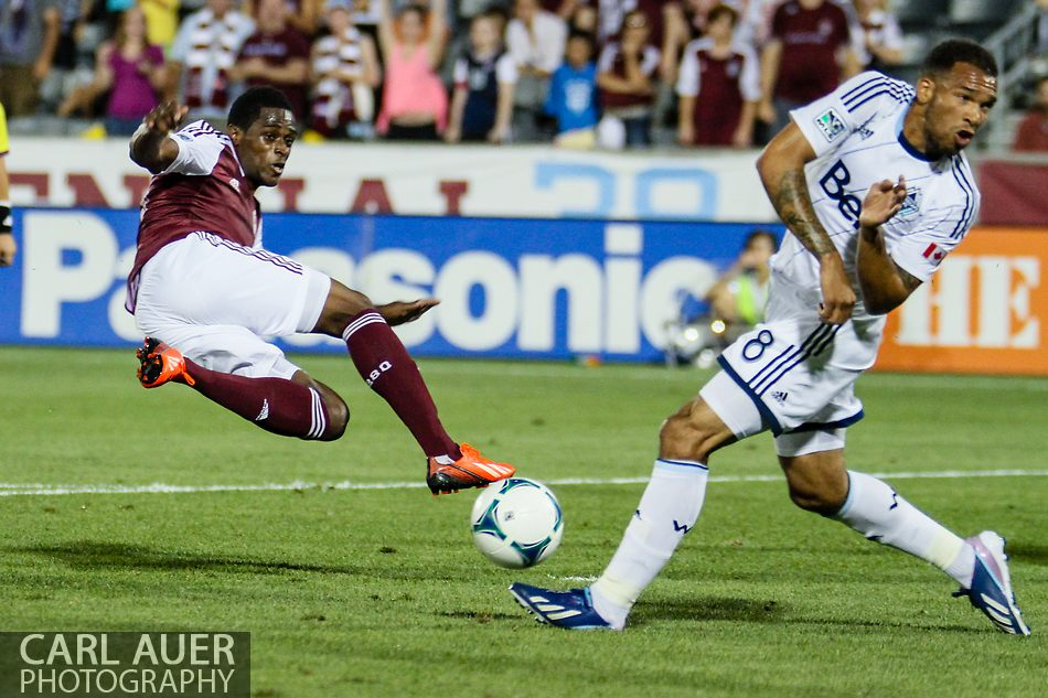 August 17th, 2013 - Colorado Rapids forward Deshorn Brown (26) attempts an acrobatic shot that is blocked by Vancouver Whitecaps FC midfielder Matt Watson (8) in second half action of the Major League Soccer match between the Vancouver Whitecaps FC and the Colorado Rapids at Dick's Sporting Goods Park in Commerce City, CO