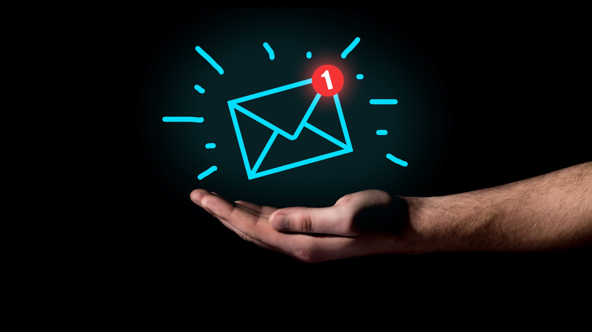 Hand holds email icon