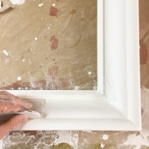 Sanding gesso on hand-made picture frame for gilding