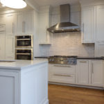 white painted, inset, chimney hood, appliance garage, subway tile