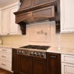 wood hood, corbels, paint glaze