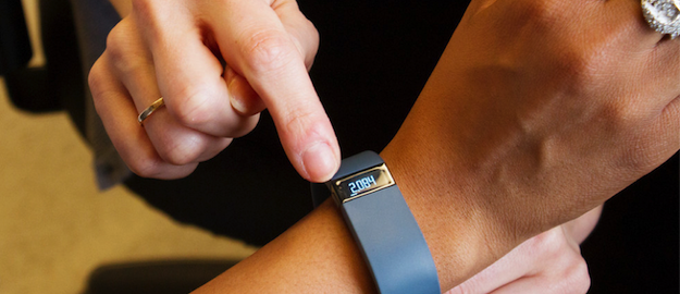 chronic disease center dietitian counseling patient on the use of a FitBit monitor