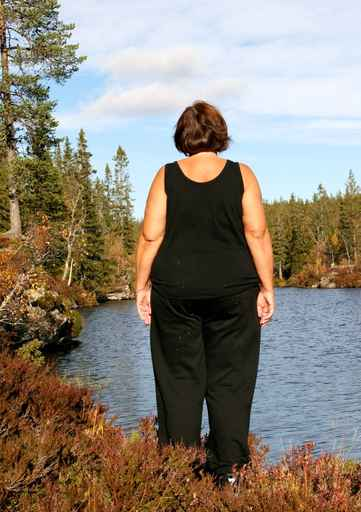 Obese woman by a tarn