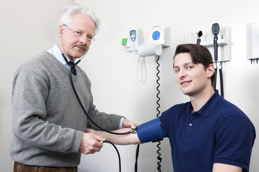 Doctor Checking Blood Pressure With Sphygmomanometer And Stethoscope Of A Patient