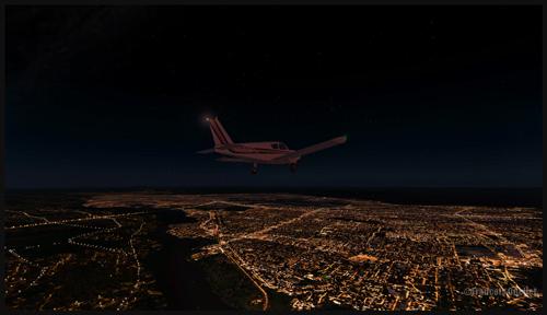 Montréal du haut des airs, la nuit, en monomoteur.