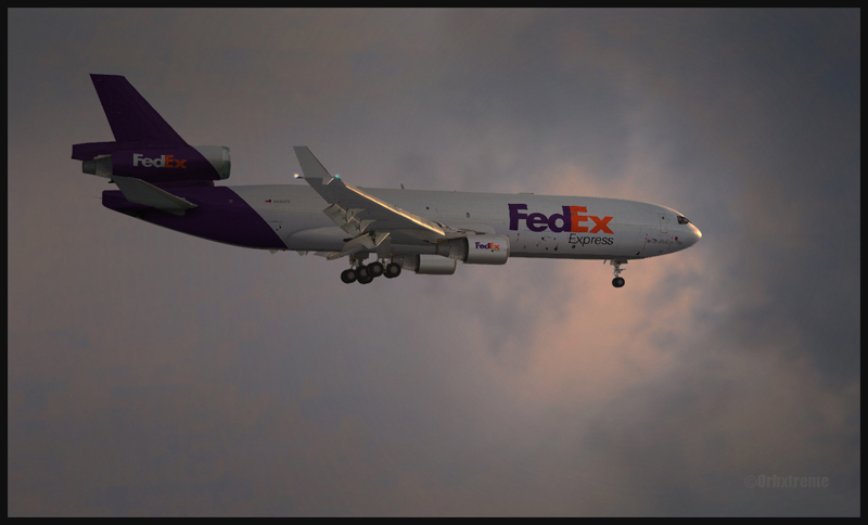 FedEx MD11 en vol (FSX). Cet appareil est une création de la compagnie PMDG