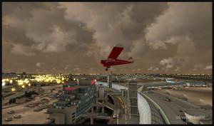 Un Piper survole l'aéroport international de Toronto. La scène se nomme FlyTampa Toronto et les nuages sont modélisés par la compagnie REX