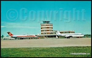 Ancien terminal de l'aéroport de Québec avec en avant-plan un DC-9 d'Air Canada et un BAC 1-11 de QuébecAir