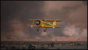 Avion de type Beech Staggerwing au-dessus de la Saskatchewan.