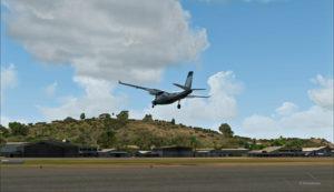 Vitesse-sol de 20 noeuds pour le Shrike Commander 500S en finale pour le hangar de Port Moresby Jacksons (AYPY).