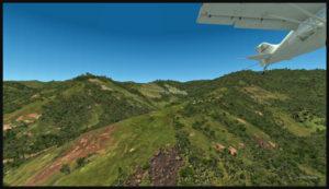Un aéronef tire un planeur au décollage de la piste en pente de Fane Parish en Papouasie Nouvelle-Guinée.