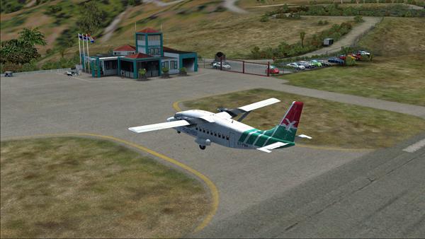 Le Shorts 360 quitte la piste 12 de l'aéroport Juancho E. Yrausquin.