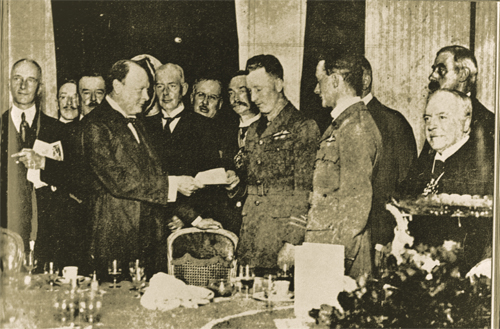 Winston Churchill is presenting the Daily Mail Check to the two pilots.