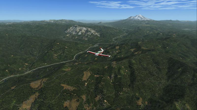 Bonanza en vol entre Mount Shasta et le barrage Shasta.