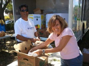 Kiwanis volunteers unloading boxes of food