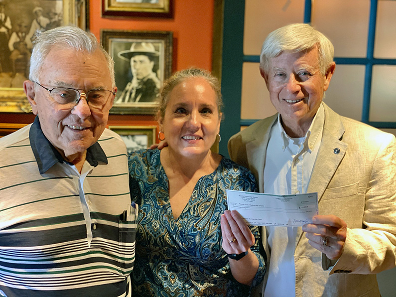 Receiving donations of $1,000 each was President Ken Dyda, left, from Peg McCartney of the Seaside Community Church and Richard Sherman.  The donations were made to the scholarship fund in honor of Connie Sherman.