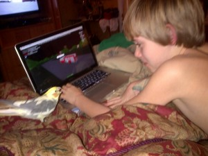 My son, our bird , and his Mac.
