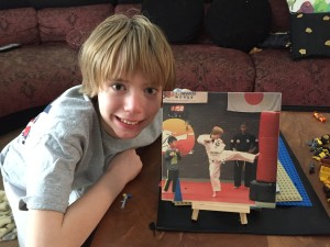 Seth and his karate Woodific photo on a wooden easel.