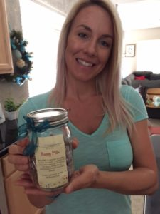 Amanda Jaramillo shows off a bottle of placenta capsules.  She is the owner of Heaven Sent Placenta Encapsulation Services in Arizona.