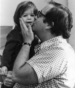 Carolyn, age 3, with her father.