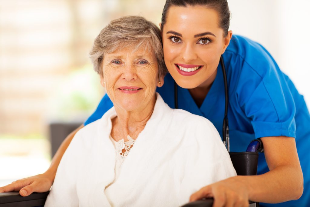17594746 - happy senior woman on wheelchair with caregiver