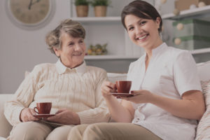 Image of private caregiver and senior female smiling