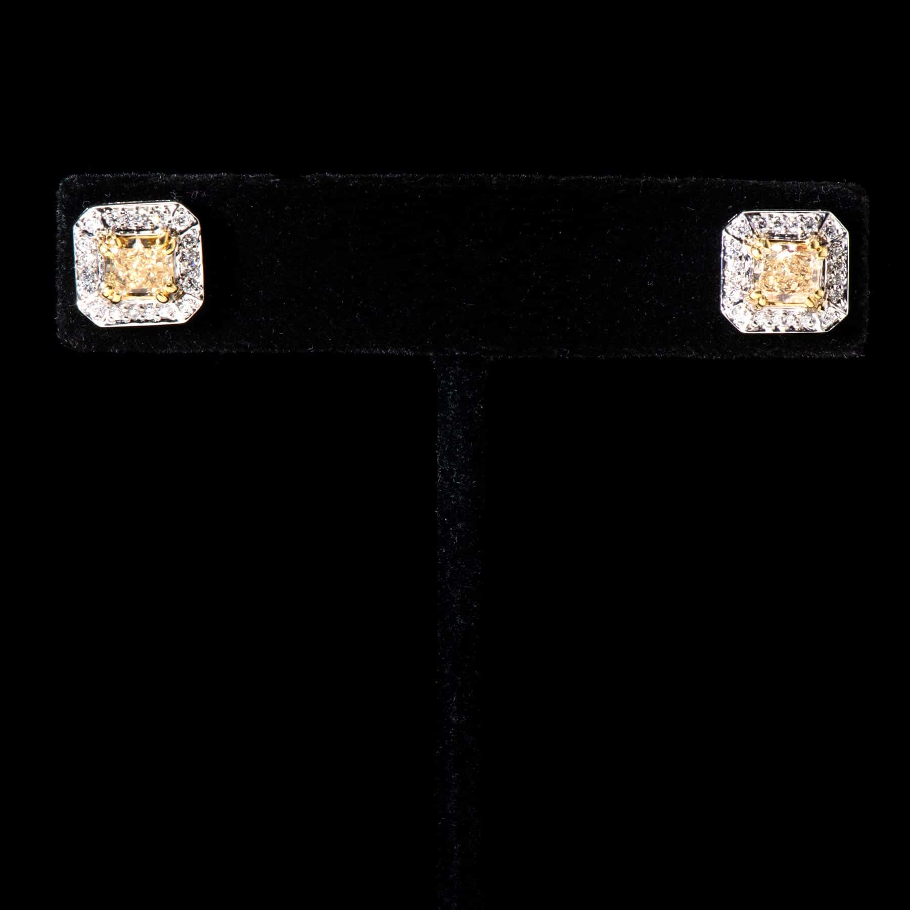 247-70MEXE 18K/W Center Y Dias. 5.03Cts 1.20Cts Studs