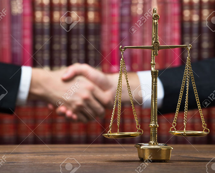 lawyers shaking hands with balance scale probate attorney in boca raton fl