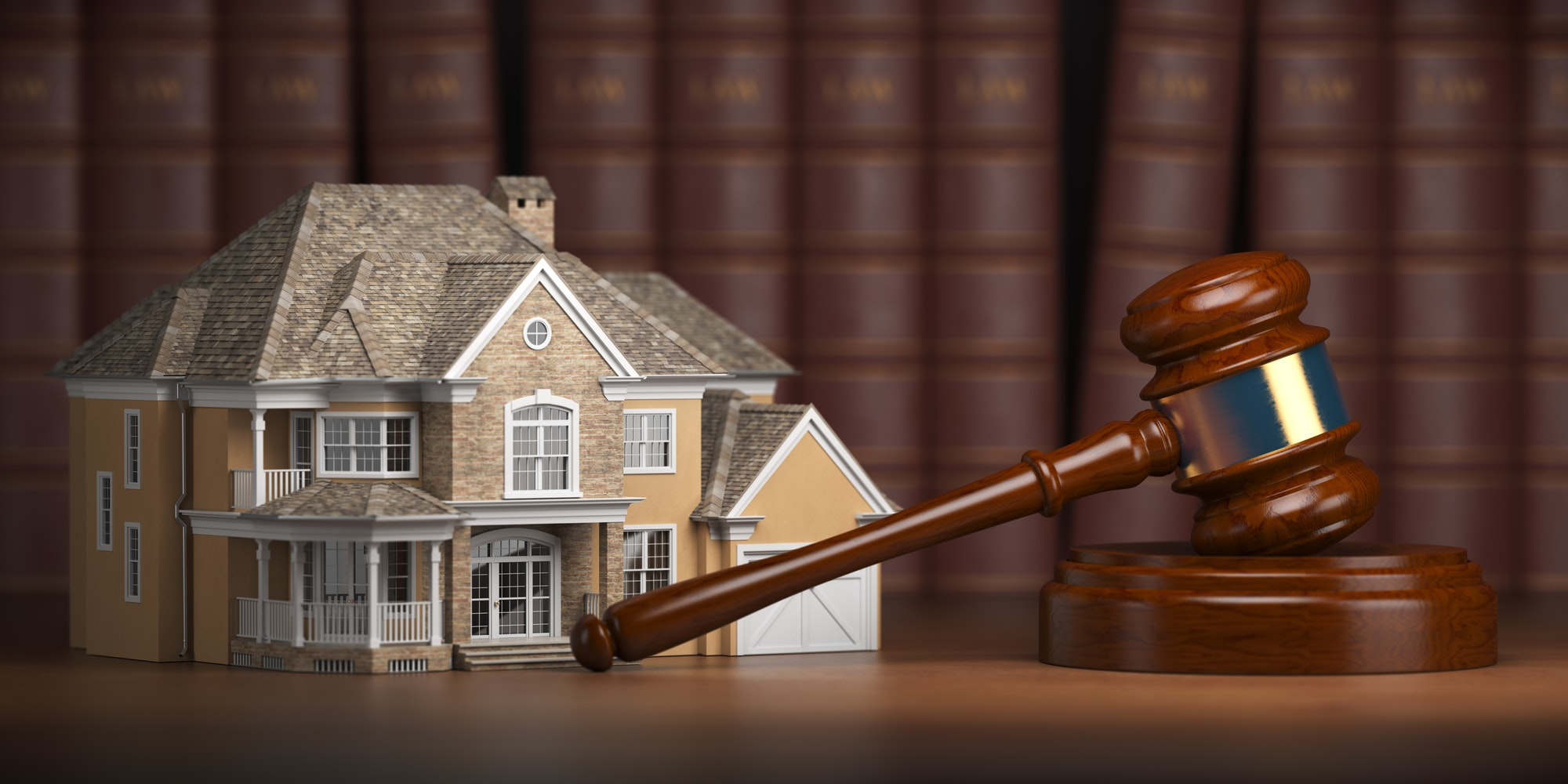 House with gavel and law books. Real estate attorney in boca raton fl