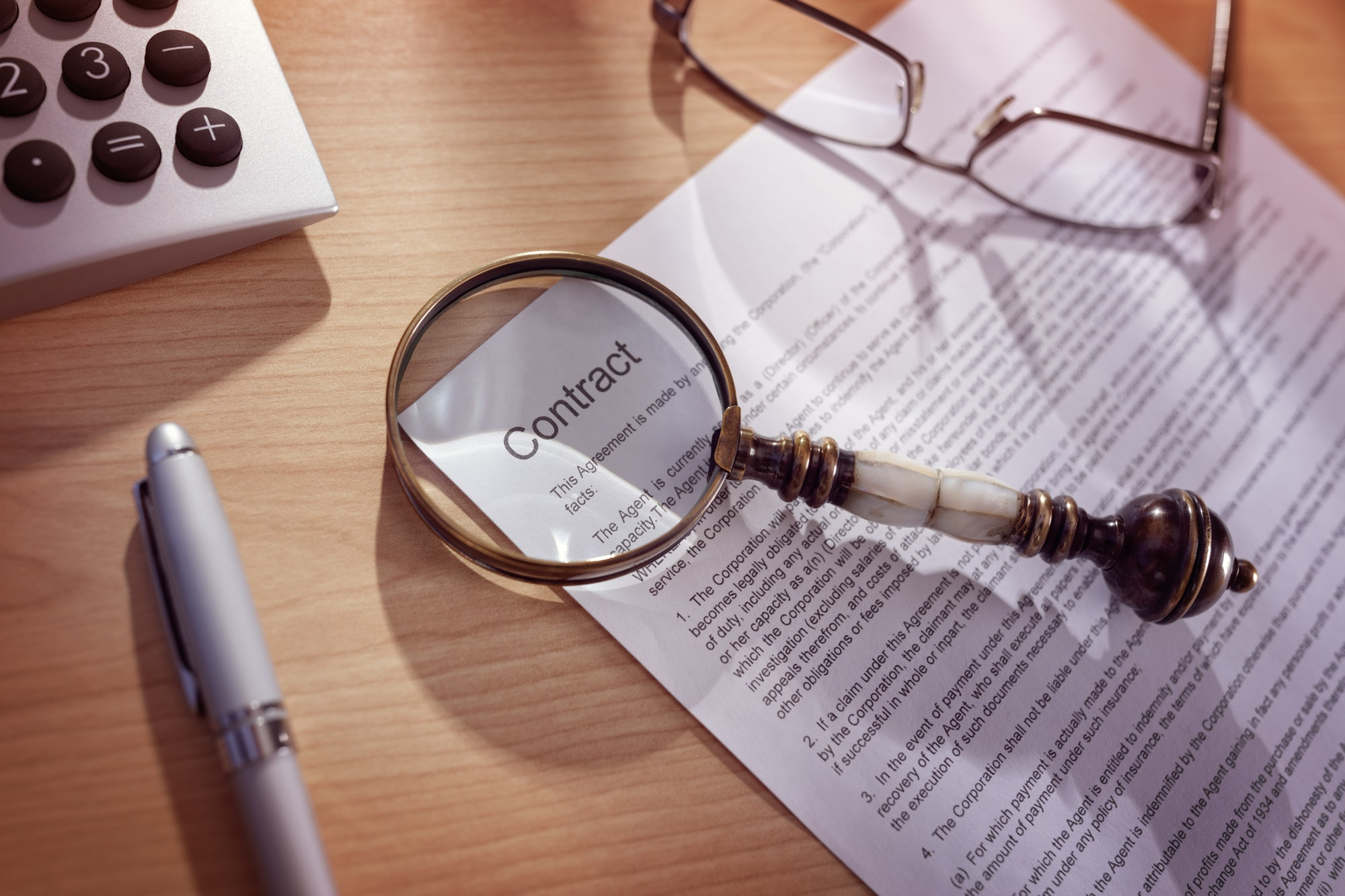 Magnifying glass on a legal breach of contract litigation attorney