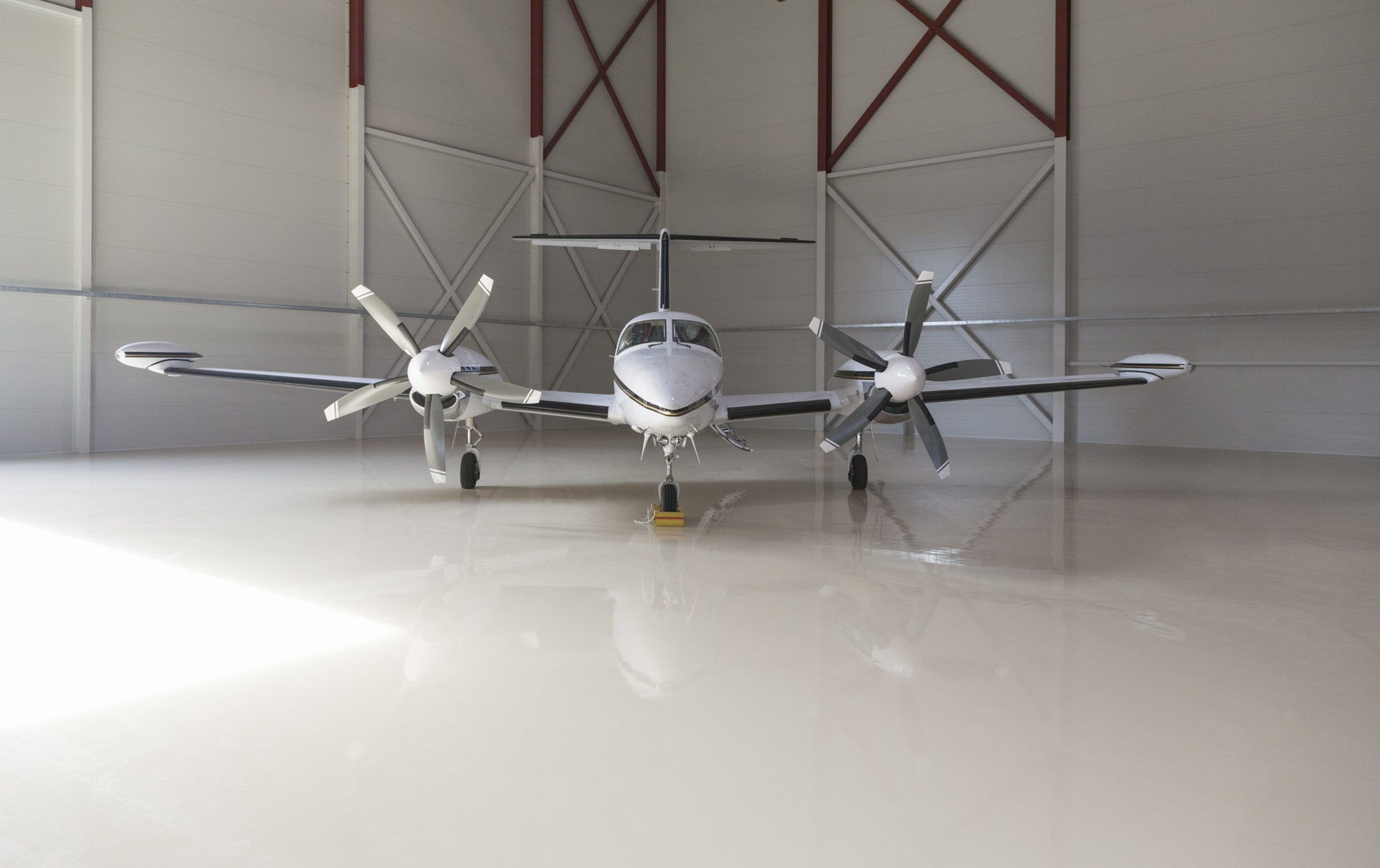 Small aircraft parked in a hangar aircraft lawyer boca raton fl
