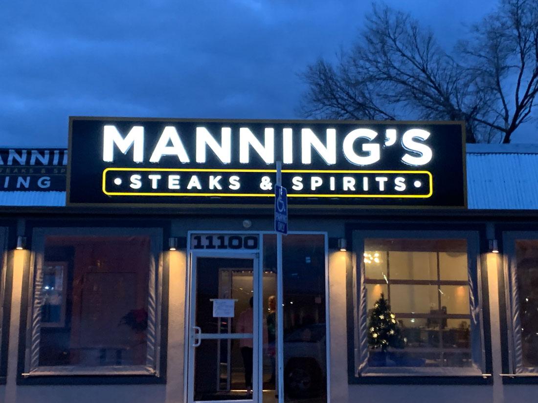 Manning's steak sign